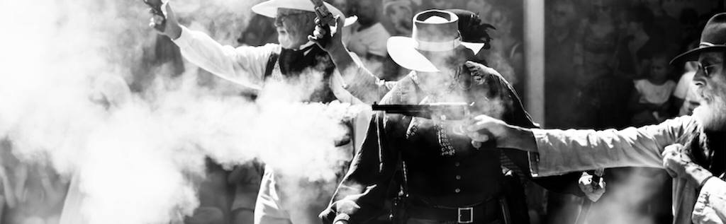 Image of cowboys shooting pistols in USA