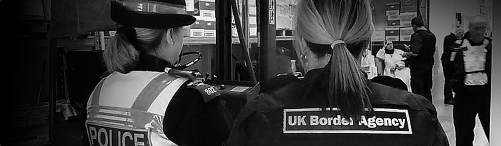 UK border agents questioning a man.